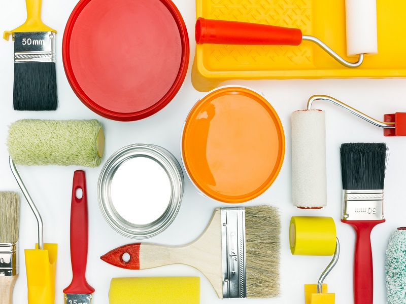 various painting tools and accessories for home renovation on white background