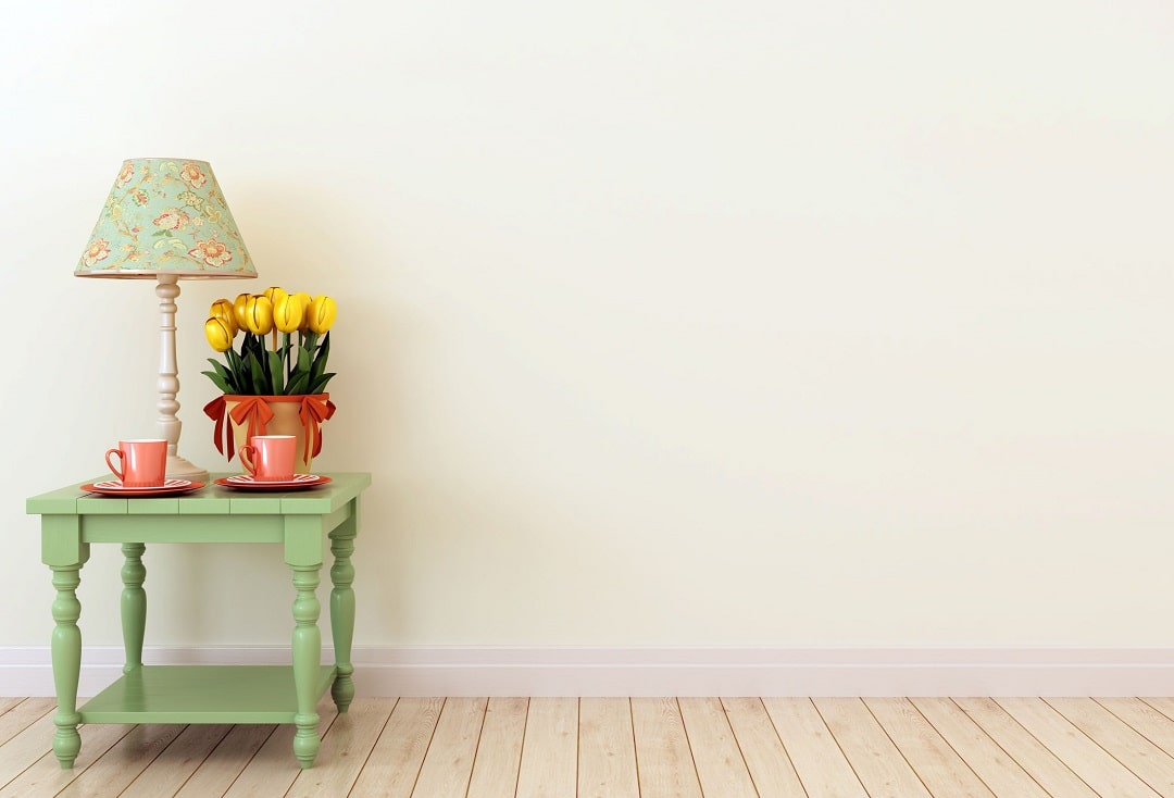 Painted wall and a table with flower - Priority One Coatings
